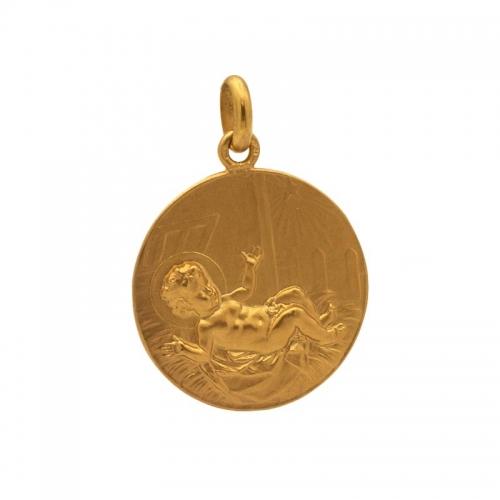 Medalla con imagen de niño...
