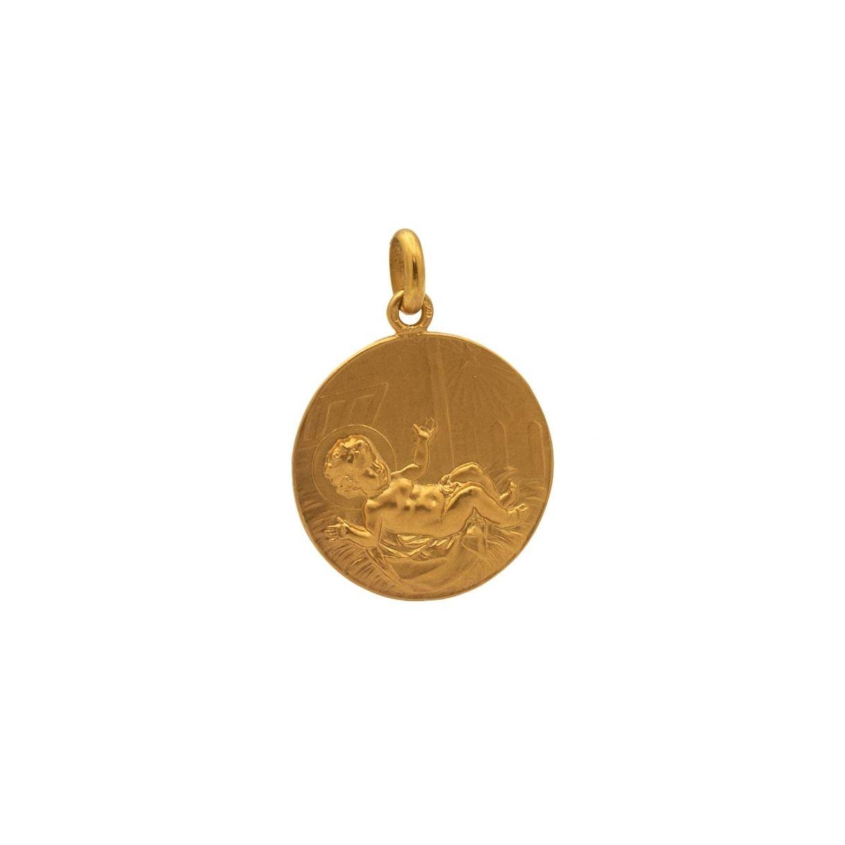Medalla con imagen de niño entre pajas
